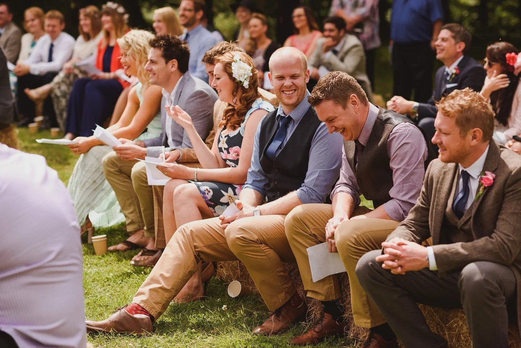 laughing guests during wedding ceremony at huntstile