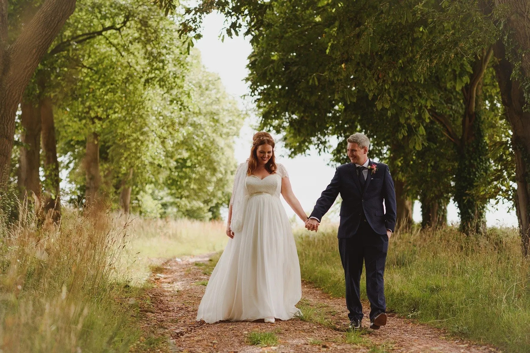 natural bride and groom portrait at outdoor wedding