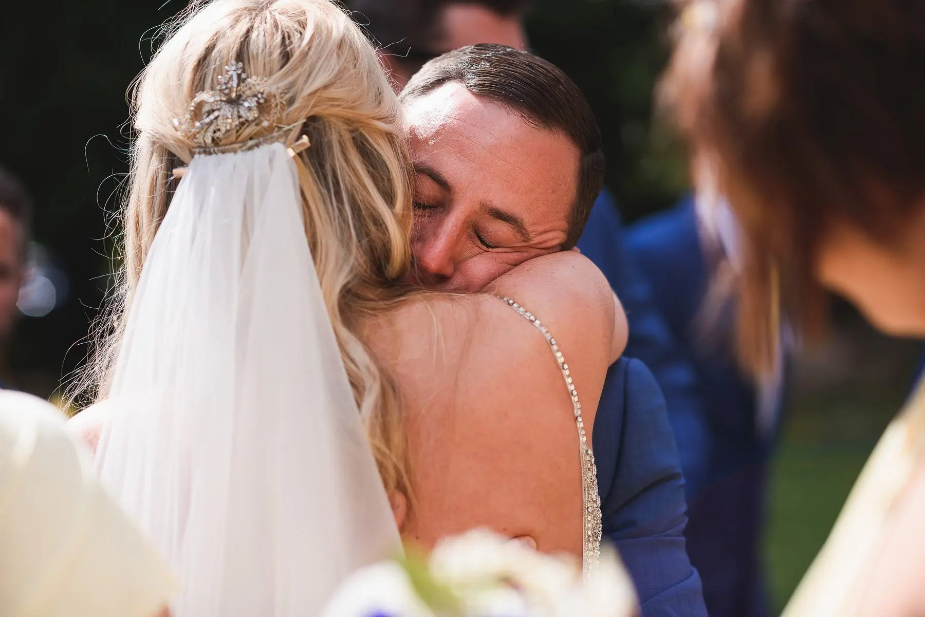 emotional groom wedding photo