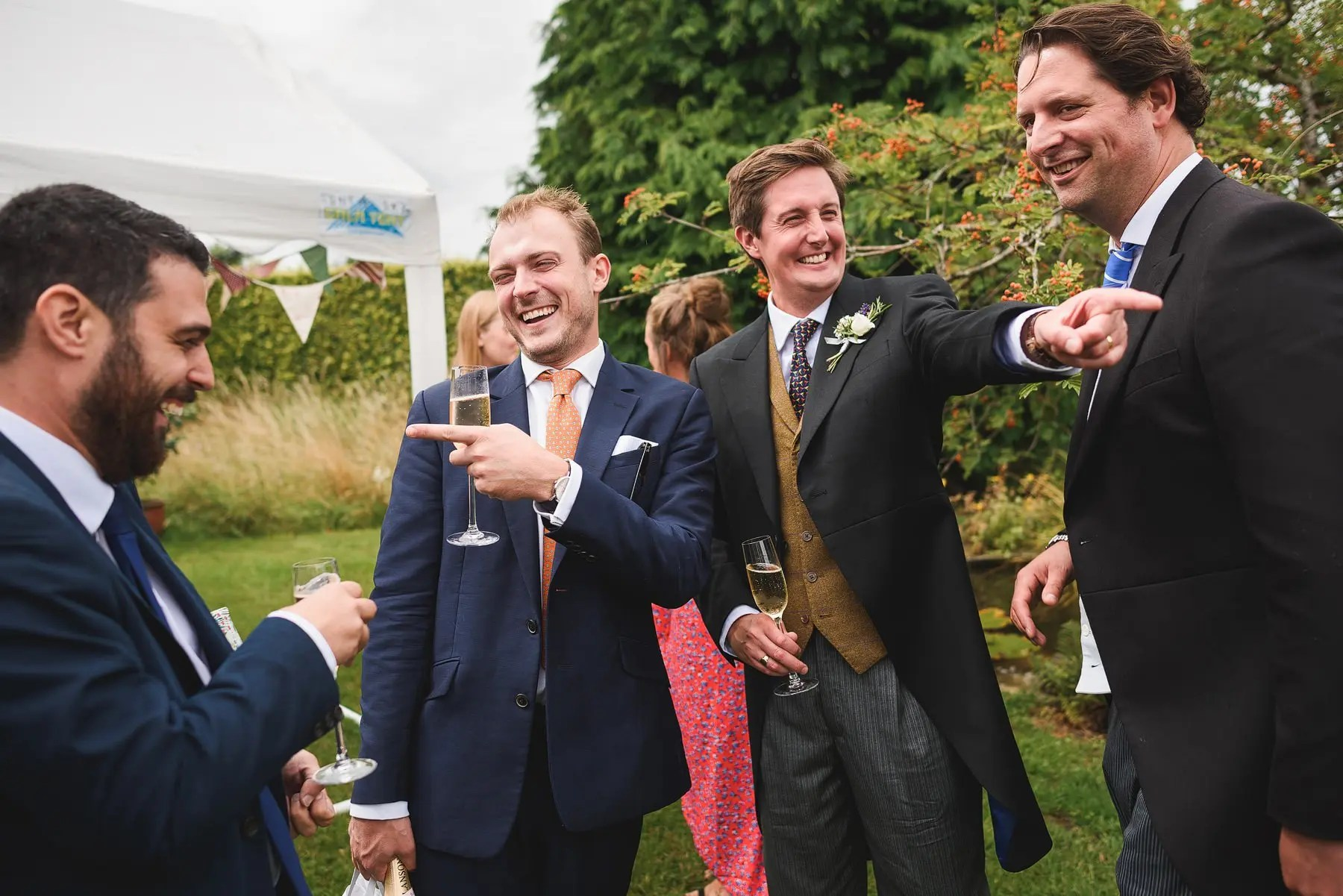 guys laughing at a somerset wedding