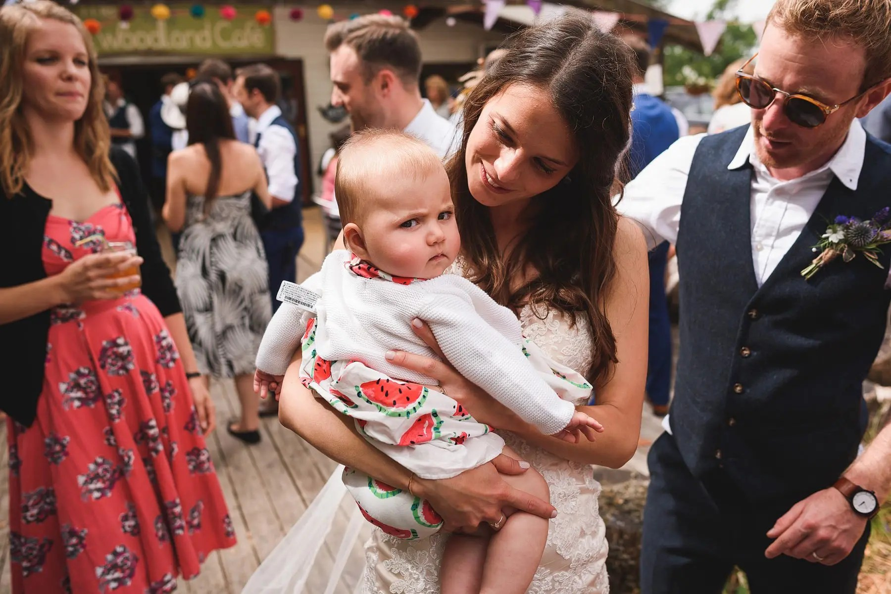 grumpy baby at a wedding