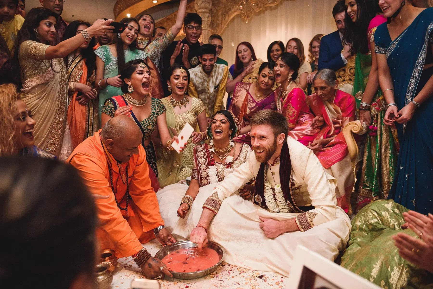 games under the mandap at an indian wedding ceremony