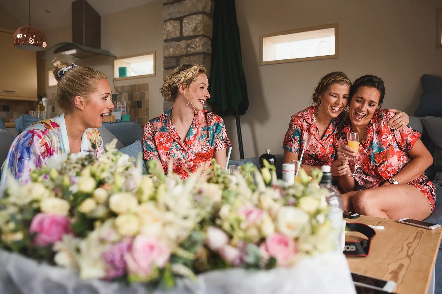bridesmaids laughing on the wedding morning