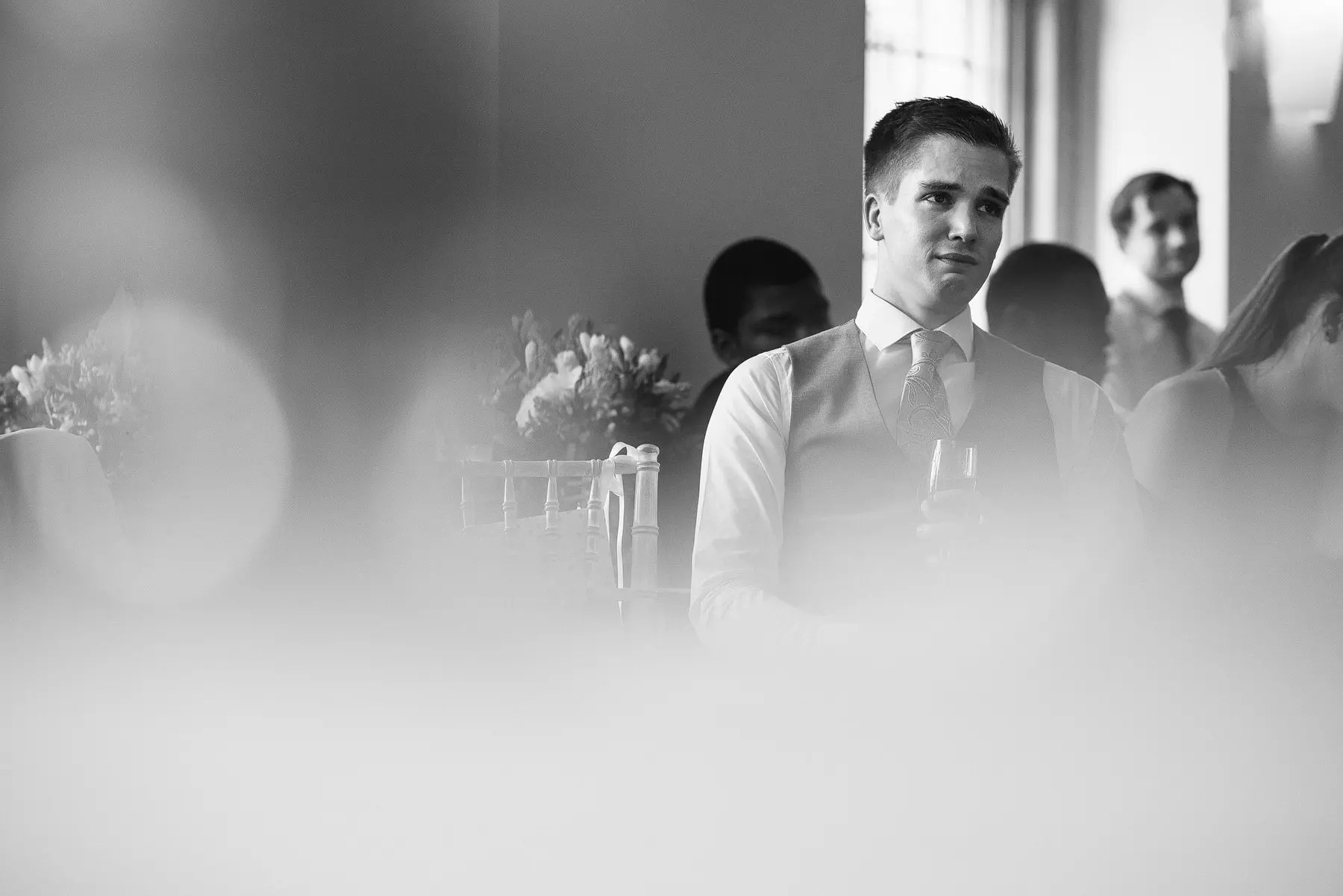 groom looking emotional during the speeches