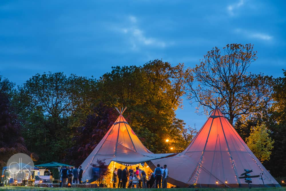 Sami Tipi 2 Giant Hat tipi wedding at night by DK Photography