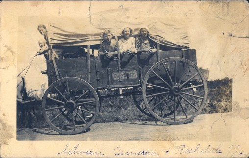 covered wagon and family