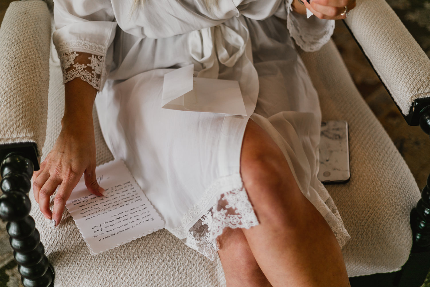 Bride reading love letter from groom.