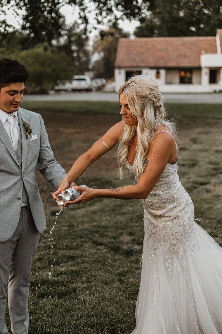 Bride and groom shotgunning beers.