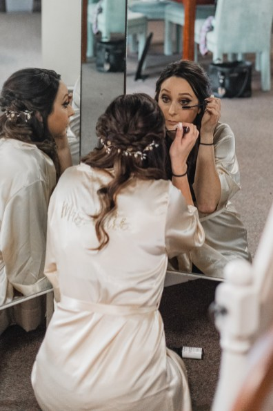 bridesmaids-bride-getting-ready-wedding-gown-hair-makeup-