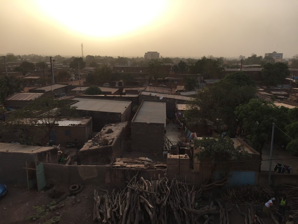 The sun is setting in Ouagadougou where the air is saturated with dust brought from the desert by the blow of the harmattan.
