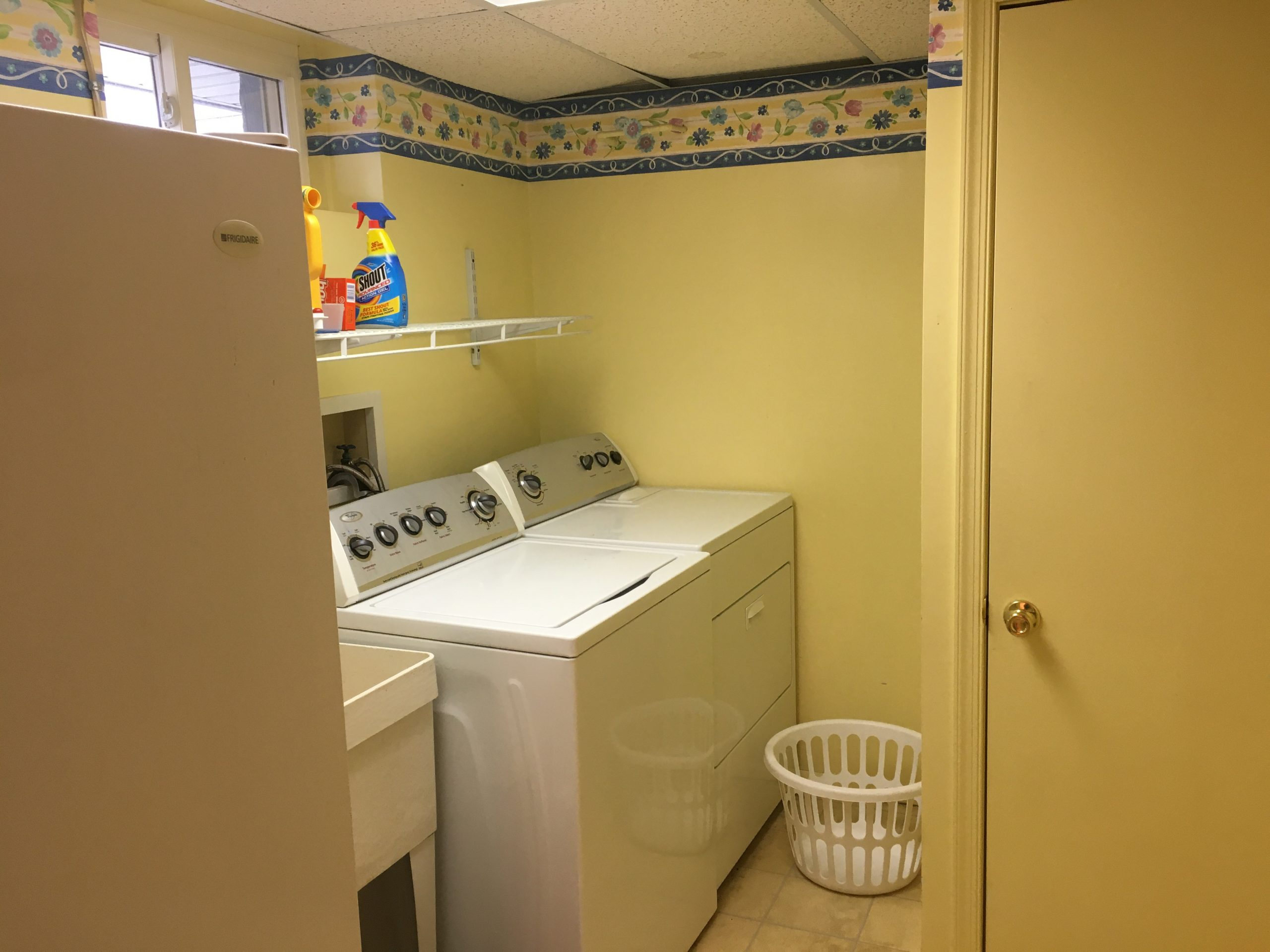 Laundry room with utility sink and extra storage