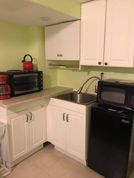 walkout basement studio across from NIH  with own bathroom and kitchenette fully furnished everything included