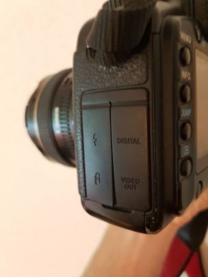 The left side of a Canon 5D with digital out, microphone and flash input.