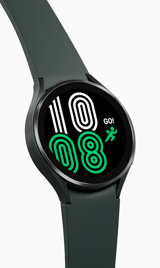 A green Galaxy Watch4 device is showing the time on its watch face in a green and white outlined design along with a green running icon.