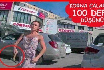 Kadın sürücü kendisine korna çalan araca çekiçle saldırdı!