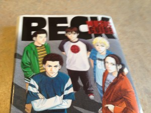 "This is a reference manga for the manga series, ""Beck.""  The manga is about a 90 lb. weakling who joins a rock band.  (I didn't end up following the manga or the anime.)   The music guide gives background to all the characters and all the real-life music influences that run throughout the manga.   If I read this, not only will I know more Japanese, I will also know more about rock and roll music history.  Amazon Japan Link."