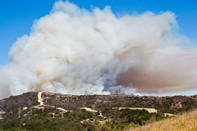 Smoke from the fire at Camp Pendleton rises above the hills at the end of Avenida Pico. Photo by Stephen Schuda
