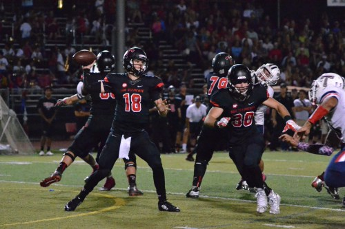 San Clemente quarterback Sam Darnold (18) threw for 256 yards and three touchdowns in the Tritons win over Aliso Niguel No. 7. Photo: Alan Gibby, zone57