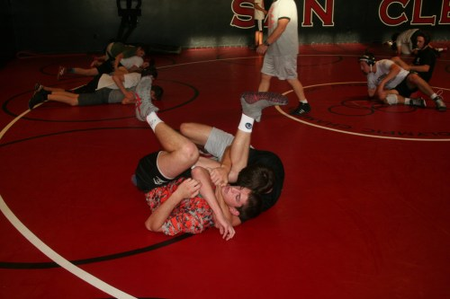 Senior Mark Marshall practices a cradle drill on Alexander Ames during a wrestling practice. Photo: Steve Sohanaki