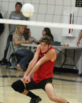 San Clemente's Liam Walsh digs out a ball during the team's match against Dana Hills on April 28. Photo: Lynn Hopper