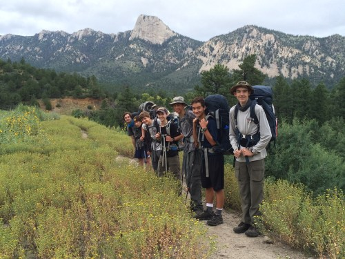 Troop 737 Scouts hike toward the peak Tooth of Time in the background. (L to R): Andrew Stefaniak, Josh Vollebregt, Christian Wentzel, Jason Keany, Johnny Burick, William Hirsh and Kyle Burick. Not pictured: Bo Burick and Dr. Jim Keany. Photo: Courtesy of Bo Burick