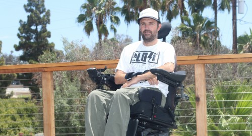 Sean Lynn sits on his porch Monday at his San Clemente home. Lynn was paralyzed in a car accident in 2014 and uses an elevator to get to the top floor of his home. Photo: Eric Heinz