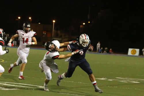 Tesoro quarterback Devon Modster passed for 324 yards and two touchdowns in the Titans 31-22 win over San Clemente Oct. 2. Photo: Eric Heinz