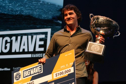 Greg Long of San Clemente accepts his WSL Big Wave World Tour Championship trophy and $100,000 prize on April 23 at the 16th annual WSL Big Wave Awards in Anaheim. Photo: Andrea Swayne