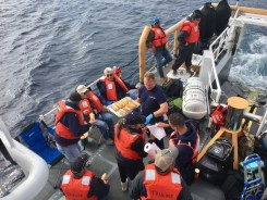 Twenty passengers are rescued by the Coast Guard Cutter Sockeye's crew after the charter fishing vessel Truline began taking on water south of San Clemente Island, California, March 19. Five crewmembers stayed aboard to assist Sockeye's crew with dewatering the vessel. Photo: Courtesy of U.S. Coast Guard