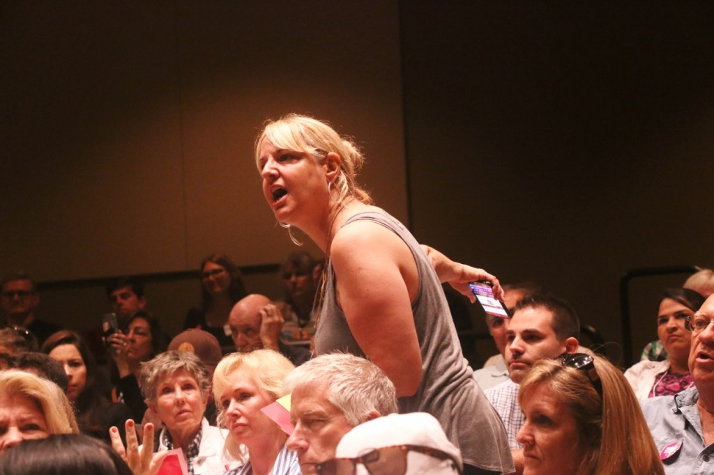 A woman shouted at Rep. Darrell Issa from the audience about an apparent staff member filling a seat. The town hall meeting Issa hosted was at maximum capacity at San Juan Hills High School on June 3. Many people could not attend because of that. Photo: Eric Heinz