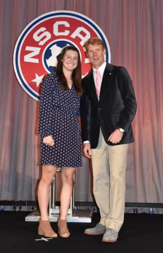 Lauren Brzykcy poses with former soccer star Alexi Lalas at an NSCAA function. Brzykcy was named a high school All-American twice. Photo: Courtesy