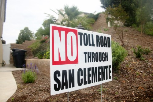 """No Toll Road Through San Clemente"" signs such as this one on Costero Risco near The Reserve are seen throughout the city's residential and commercial properties. The Reserve homeowners association and the city of San Clemente both recently filed lawsuits against the Transportation Corridor Agencies regarding items related to toll road construction. Photo: Eric Heinz"
