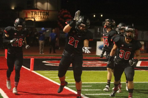 Shane Lockett (21) celebrates during a game against Edison. Photo: Eric Heinz