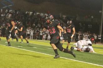 Austin Whitsett carries the ball against Murrieta Valley. Photo: Eric Heinz