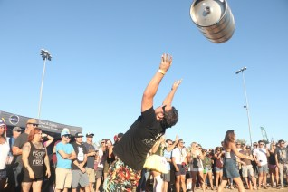 A competitor tosses an empty beer keg over the back of his head during the beer keg bowling contest during the 2016 San Clemente Oktoberfest. Photo: File