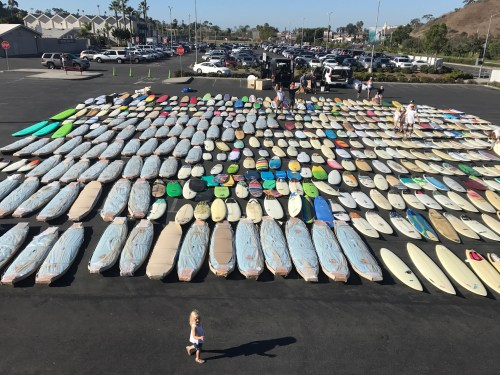 Positive Vibe Warriors are sending more than 680 surfboards, pictured here on Oct. 7 at San Clemente High School, to underprivileged children in South Africa. Photo: Courtesy of Positive Vibe Warriors.