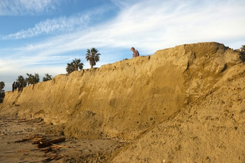 Many scientific studies claim the California coast could see up to 4 and a half feet of sea level rise by the end of the century. Pictured, sand at North Beach was eroded significantly in early 2017. Photo: Eric Heinz