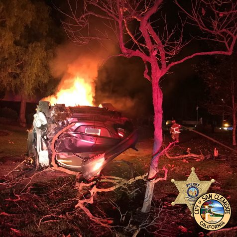 A vehicle overturned and caught fire following a driver hitting a median early Jan. 27 morning. Photo: Courtesy of San Clemente Police Services