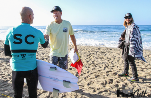 Eric Diamond, executive chairman of the Dana Point Surf Club, shaking hands with Matt Archbold of the San Clemente Surf Club. Photo: Ron Lyon