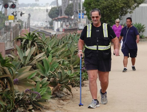San Clemente's Mycle Brandy, 67, who has walked across America and up and down the nation's east and west coasts to inspire stroke patients, sets out from North Beach on a practice walk for a planned walk across the continent. Photo: Fred Swegles