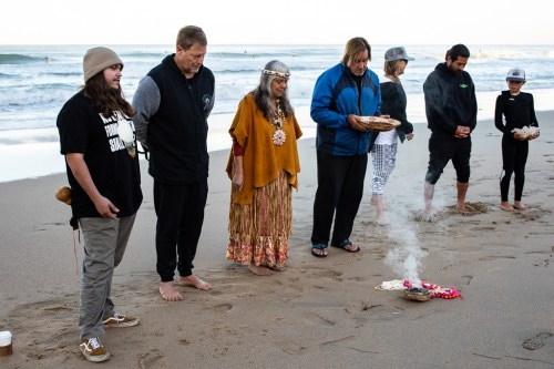 Members of the Acjachemen Nation hold a ceremony prior to the Dana Point Surf Shop Challenge on Saturday, March 30, at Salt Creek.  Photo: Luke Gonia