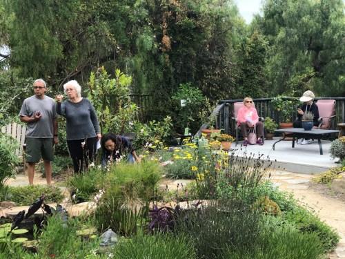 Visitors explore a backyard garden at a home in San Juan Capistrano. /Photo by Freda D'Souza