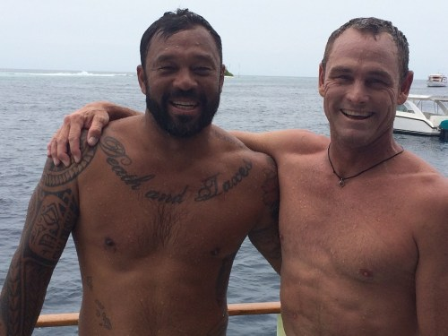 From left, professional surfers Sunny Garcia and Taylor Knox pose together for a picture in the Maldives. Photo by: Jake Howard