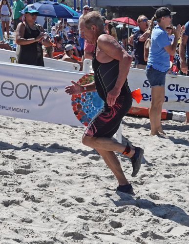 San Clemente teacher/artist Rick Delanty, 68, has competed in 41 of the 43 San Clemente Ocean Festivals. This year, he ran/swam two events. Photo: Fred Swegles