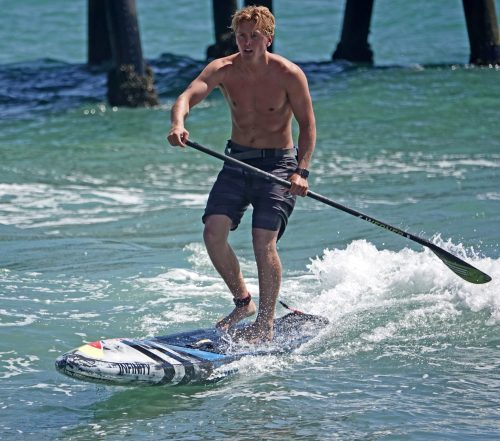 Dana Point's Tyler Bashor powered his way to first place in the San Clemente Ocean Festival's SUP sprint. Photo: Fred Swegles