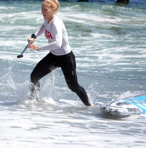 Candice Appleby, a world-class stand-up paddle boarder from San Clemente, won the women's division of an SUP sprint at the Ocean Festival. Photo: Fred Swegles