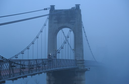 Fog at Passerelle du College bridge over the Rhone river.