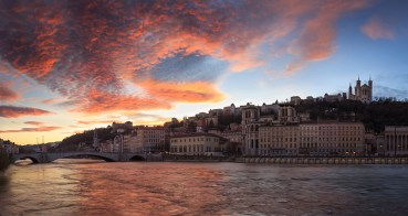 Colorful sunset over Vieux-Lyon and the the Saone river at Quai des Celestins.