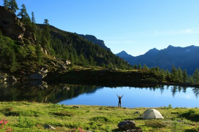 Joy at a tranquil lake in Ticino.