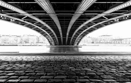 Empty street under a bridge in Lyon on a cold winter day.